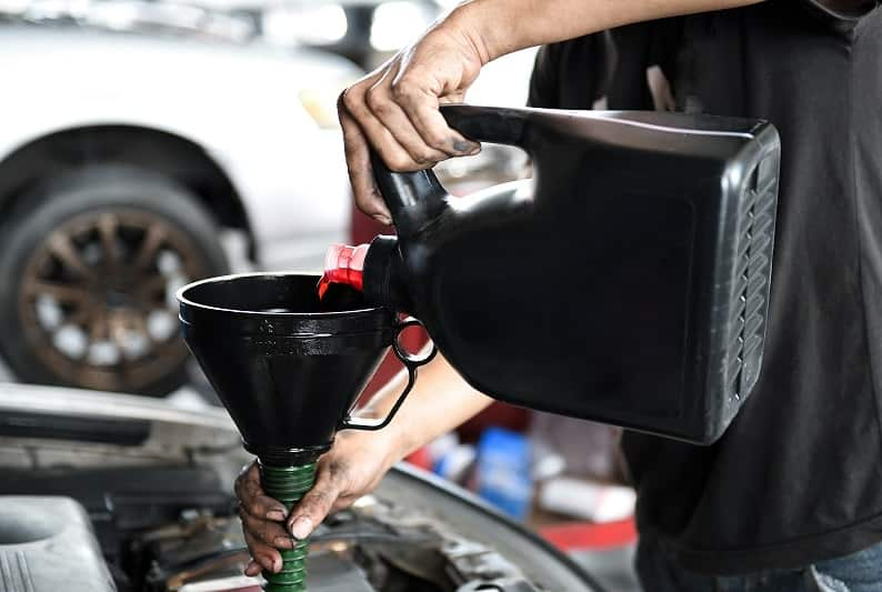 adding engine oil - oil change Maple Ridge BC - Express Care